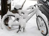 Bicycle covered with snow — Stock Photo