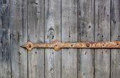 Peeling paint on grunge wooden surface — Stock Photo