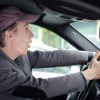 Watch out! Upset man driving and seeing something dangerous — Stock Photo