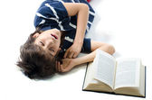 Young student sleeping with open book next to him — Stock Photo