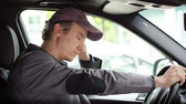 Bored man at the wheel of his car sleeping — Stock Photo