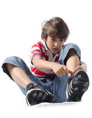 Child putting on sneakers — Stock Photo