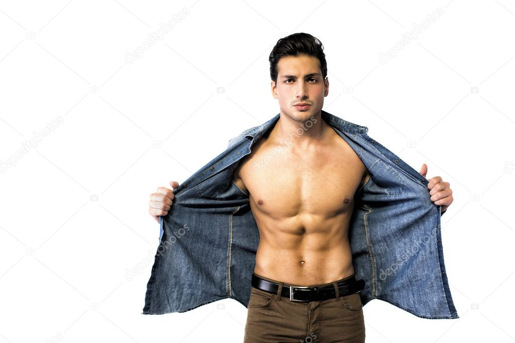 Latin young man opening denim shirt on naked chest — Stock ...