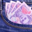 Ukrainian grivna in jeans pocket — Stock Photo
