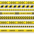 Stockvektor : Set of caution tapes.