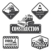 Set of under construction emblems, labels and designed elements — Stock Vector