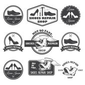 Set of vintage shoes repair labels, emblems and designed element — Stock Vector