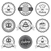 Set of vintage black and white bakery emblems, labels and design — Stock Vector