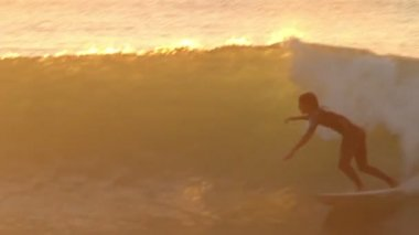 Silhouette Surfer Riding Wave At Sunset — Stock Video