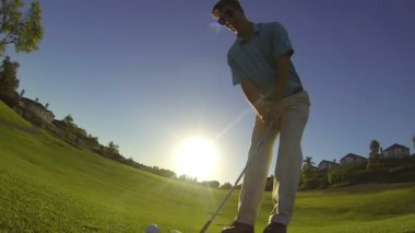 Slow Motion Young Man Golfing At Golf Course — Stockvideo