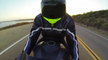 POV Man Riding Motorcycle At Sunset — Stock Video