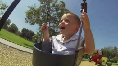 POV Shot of baby boy at park on sunny summer day — Video Stock