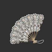 Wooden with lace oriental fan — Stock Photo