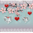 Love sakura tree with hanging red and lace hearts — Stock Photo