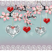 Love sakura tree with hanging red and lace hearts — Stok fotoğraf
