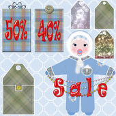 Baby clothes sale tags with percentages — Stock Photo