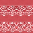 White seamless lace pattern on red background — Stock Photo #38865139