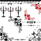 Set of candelabra and candlesticks with candles — Stock Photo