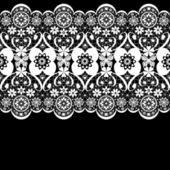 White seamless lacy lace pattern on black — Stock Photo