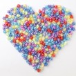 Heart-shaped plastic stars — Stock Photo
