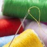 Spool of thread with needle — Stock Photo