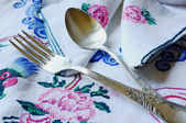 Embroidery & cutlery — Stock Photo