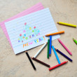 Small colored pencils & a drawing — Stock Photo
