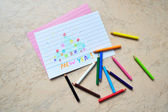 Small colored pencils & a drawing — Stockfoto