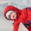 Stock Photo: Little girl wearing warm jumpsuit in ice town at winter outdoor