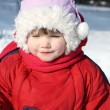 Little beautiful girl wearing warm clothing walks in winter fore — Foto Stock