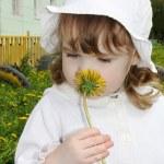 Beautiful little girl wearing white panama and blouse looks yell — Stock Photo #28606081