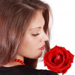 Back and profile of young woman with red rose on her shoulder is — Stock Photo