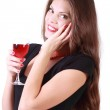 Beautiful smiling girl holds glass of red wine and looks at came — Stock Photo #28609717