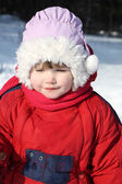 Little beautiful girl wearing warm clothing walks in winter fore — Stock Photo