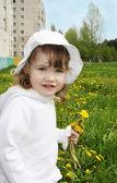 Cute little girl wearing white panama and blouse holds yellow da — Stock Photo
