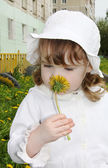 Beautiful little girl wearing white panama and blouse looks yell — Stock Photo