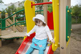 Cute little girl wearing white blouse prepares for rolling at sl — Stock Photo