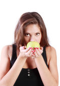 Beautiful brunette girl sniffs green apple isolated on white bac — Stock Photo