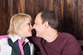 Happy wife and husband touch each other noses and smile near woo — Stok fotoğraf