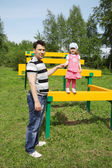Happy little cute girl with her father at playground at summer d — Stock Photo
