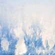 Beautiful blue frosted glass and bright sun shines through patte — Stock Photo