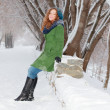 Beautiful girl in green overcoat poses outdoor at winter day in — Stock Photo #38446839