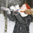 Happy girl in black jacket throws up snow in woods at winter. — Stock Photo #38446847