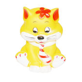 Small rubber yellow toy cat in tie isolated on a white backgroun — Stock Photo