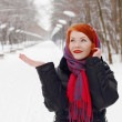 Pretty happy girl in red kerchief catches snowflakes outdoor at — Stock Photo