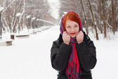 Pretty happy girl in red kerchief smiles outdoor at winter day i — Stock Photo