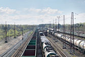 Many long freight trains at railway station with many wires at s — Foto Stock