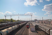 Many long passenger and freight trains at railway station at spr — Foto Stock