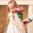 Little beautiful girl in white dress and male hands with big pin — Stock Photo #49873553