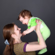 Portrait of happy mother playing with her cute little son — Stock Photo #49874001